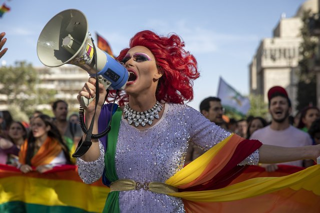 A participant dances in the annual Gay Pride parade in Jerusalem, Thursday, June 3, 2021. (Photo by Ariel Schalit/AP Photo)