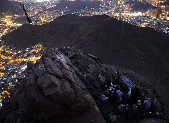"Muslims pray as they visit the Hira cave at the Mount Al-Noor during their Umrah Mawlid al-Nabawi ""Birthday of Prophet Mohammad"" in the holy city of Mecca, Saudi Arabia January 16, 2016. Muslims believe Prophet Mohammad received the first words of the Koran through Gabriel, at the top of Mount Al-Noor in the holy city of Mecca. (Photo by Amr Abdallah Dalsh/Reuters)"
