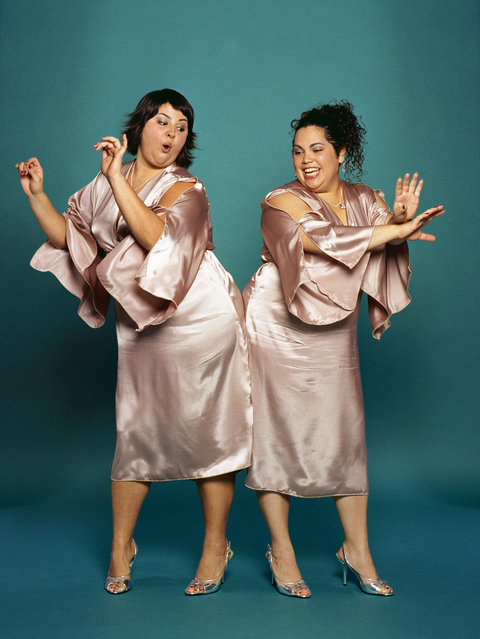 Two plus-sized bridesmaids dancing. (Photo by Creatas/Getty Images)