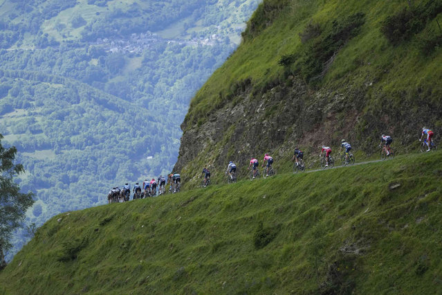 The pack speeds down Col de Val Louron-Azet pass during the seventeenth stage of the Tour de France cycling race over 178.4 kilometers (110.9 miles) with start in Muret and finish in Saint-Lary-Soulan Col du Portet, France, Wednesday, July 14, 2021. (Photo by Daniel Cole/AP Photo)