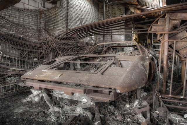 Stunning images reveal the vulnerable beauty of abandoned cars that have been left to rust over the years. The collection of spectacular images show how a Volkswagen Beetle, Citroën C2 and even a Ferrari have been taken over by nature and piles of rubble. In other shots, a Mercedes Benz is overgrown with ivy and an old-fashioned BMW has been left in a garage with a collapsing roof and debris on the floor. A Ford vehicle has also been forgotten in the woods and one car even appears to have a tree growing from it. The haunting images were taken by Belgian security guard, Kenneth Provost (31) at various locations across Germany and Belgium. Here: A Ferrari with parts missing stands forgotten in a workshop. (Photo by Kenneth Provost/Mediadrumworld.com)