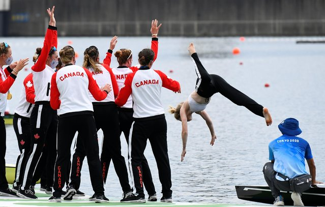 Canada Women's Eight throw coxwain Kristen Kit into the water after winning gold in the Women's Eight final at the Sea Forest Waterway during the 2020 Tokyo Summer Olympic Games in Tokyo, Japan on July 30, 2021. (Photo by Piroschka van de Wouw/Reuters)