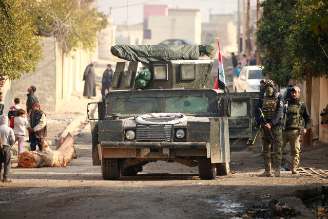 An Iraqi rapid response forces military vehicle is seen during battle with Islamic State militants in the Mithaq district of eastern Mosul, Iraq, January 4, 2017. (Photo by Thaier Al-Sudani/Reuters)