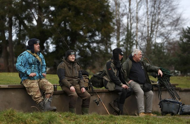 Anglers sit on on a wall after fishing on the opening day of the salmon fishing season on the River Tay at Kenmore in Scotland, Britain January 16, 2017. (Photo by Russell Cheyne/Reuters)