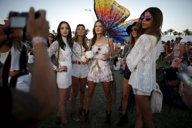 Victoria's Secret model Alessandra Ambrosio of Brazil (C) poses for a photo with friends at the Coachella Valley Music and Arts Festival in Indio, California April 12, 2015. (Photo by Lucy Nicholson/Reuters)