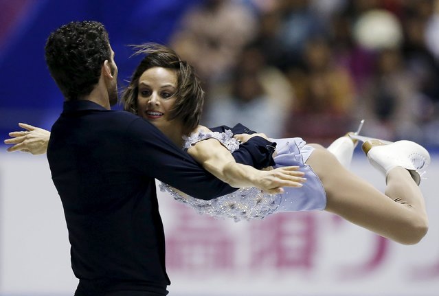Meagan Duhamel and Eric Radford of Canada compete during the pairs short program at the ISU World Team Trophy in Figure Skating in Tokyo April 17, 2015. (Photo by Yuya Shino/Reuters)