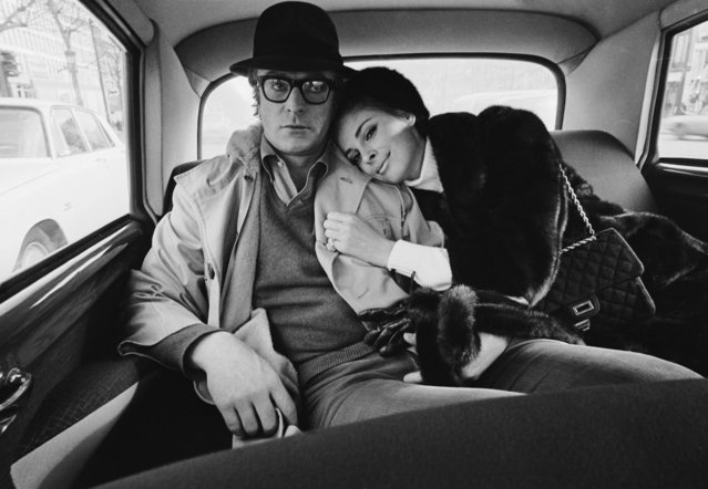 "American actress Anjanette Comer snuggles up to English actor Michael Caine in Berlin during the filming of ""Funeral in Berlin"", circa 1966. Comer was originally chosen for the part of Samantha Steel, but was replaced by Eva Renzi due to illness. (Photo by Terry O'Neill/Hulton Archive/Getty Images)"