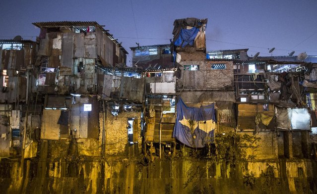 Windows of various shanties in Dharavi, one of Asia's largest slums, are seen  in Mumbai January 28, 2015. The rent for a 100 square feet (9.29 square meters) shanty in Dharavi ranges from 2.5 Indian rupees ($ 0.04) per square feet to 3.5 Indian rupees ($ 0.06) per square feet. (Photo by Danish Siddiqui/Reuters)