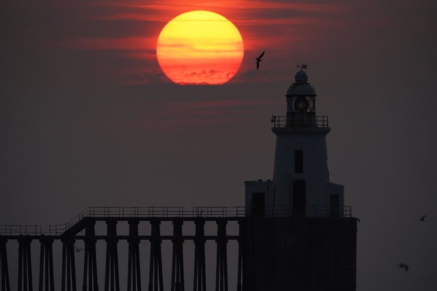 The sun rises through the sea mist at Blyth pier in Northumberland, United Kingdom on Tuesday,  July 27, 2021. (Photo by Owen Humphreys/PA Images via Getty Images)