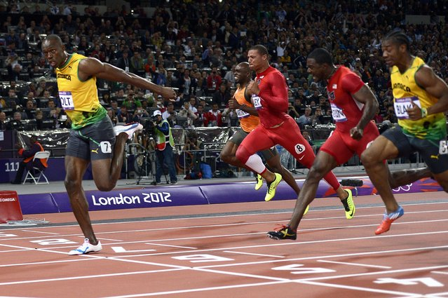Jamaica's Usain Bolt wins the men's 100m final at the athletics event during the London 2012 Olympic Games on August 5, 2012 in London. (Photo by Adrian Dennis/AFP Photo)