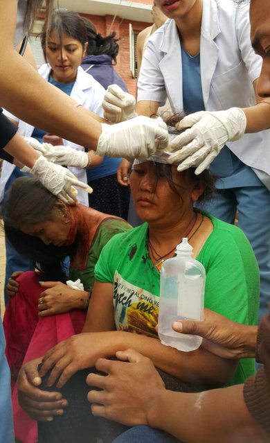 Injured people receive treatment in Kathmandu, Nepal, Saturday, April 25, 2015. (Photo by Tashi Sherpa/AP Photo)