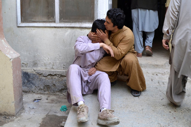 Men mourn the death of a relative at a hospital after a blast at a vegetable market in Quetta, Pakistan April 12, 2019. At least 16 people were killed and 30 wounded in a powerful blast on April 12 apparently targeting the Shia Hazara ethnic minority at a busy fruit market in Pakistan's southwestern city of Quetta, officials said. (Photo by Reuters/Stringer)