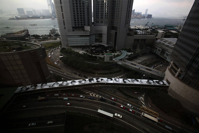 "A display part of the ""Inside Out"" project is seen on the roof of a foot bridge at Hong Kong's Financial Central District September 21, 2012. (Photo by Bobby Yip/Reuters)"