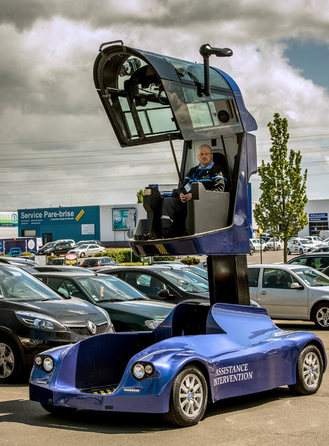 "A man drives the ""Iris viseo"", an electric surveillance vehicle with a telescopic cockpit designed and manufactured in France at the car park of a shopping centre in Noyelles-Godault on May 6, 2015. (Photo by Philippe Huguen/AFP Photo)"