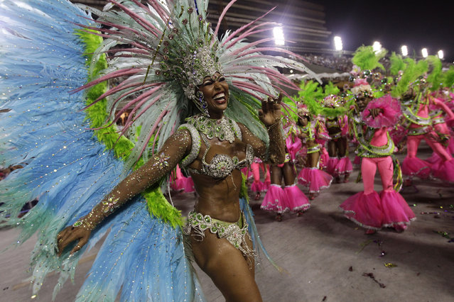 Performers from the Mangueira samba school parade during carnival celebrations at the Sambadrome in Rio de Janeiro, Brazil, Monday, March 3, 2014. (Photo by Silvia Izquierdo/AP Photo)