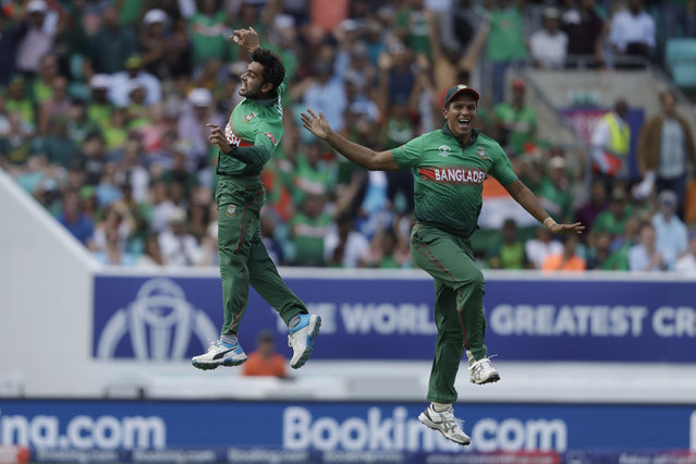 Bangladesh's Mehedi Hasan, left, celebrates taking the wicket of South Africa's captain Faf du Plessis during the Cricket World Cup match between South Africa and Bangladesh at the Oval in London, Sunday, June 2, 2019. (Photo by Matt Dunham/AP Photo)
