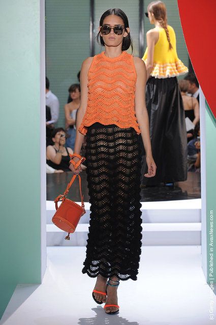 A model walks the runway at the Kenzo Spring Summer 2012 fashion show during Paris Fashion Week