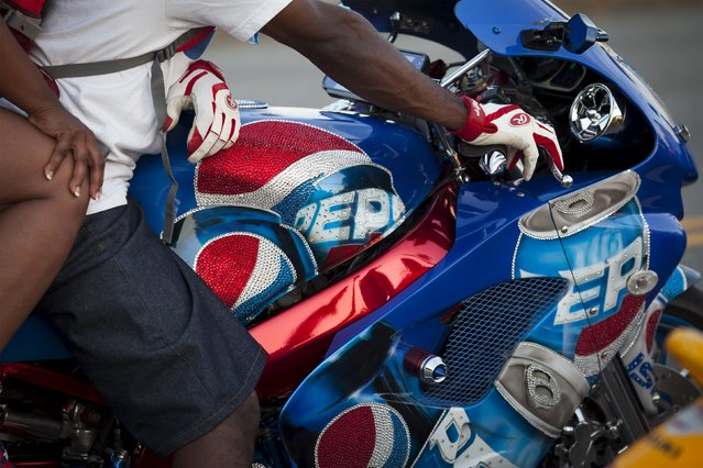 A custom Pepsi themed sport bike sits idle by the extreme traffic on Ocean Boulevard during the 2015 Atlantic Beach Memorial Day BikeFest in Myrtle Beach, South Carolina May 24, 2015. (Photo by Randall Hill/Reuters)