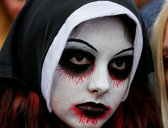 """A participant takes part in a """"Zombie Walk"""" parade in Kiev, Ukraine October 27, 2018. (Photo by Gleb Garanich/Reuters)"""