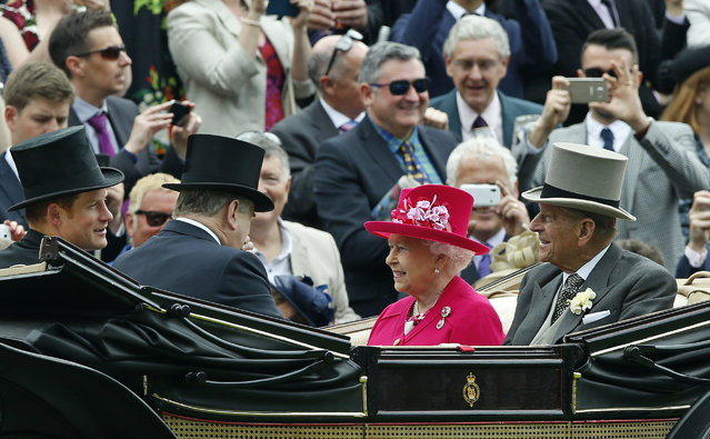Britain's Queen Elizabeth II arrives with Prince Philip, the Duke of Edinburgh and Prince Harry for the first day of  Royal Ascot horse racing meet at Ascot, England, Tuesday, June 16, 2015. Royal Ascot is the annual five day horse race meeting that Britain's Queen Elizabeth II attends every day of the event. (AP Photo/Alastair Grant)