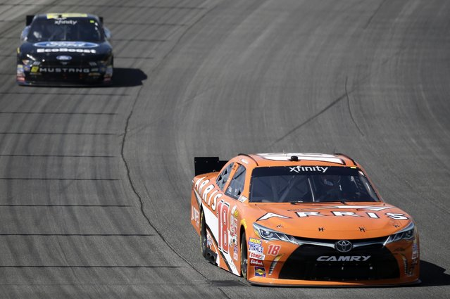 Daniel Suarez (18) drives during the NASCAR Xfinity series auto race at Chicagoland Speedway, Sunday, June 21, 2015, in Joliet, Ill. (AP Photo/Nam Y. Huh)