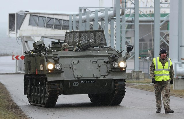 A British Army aromured vehicle of the 5th Battalion The Rifles drives up from a ship dock after it and other heavy vehicles arrived by ship on March 22, 2017 at Paldiski, Estonia. (Photo by Sean Gallup/Getty Images)