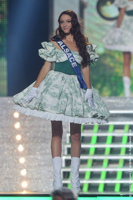 Miss Alsace, Delphine Wespiser walks along the stage during Miss France 2012 Beauty Pageant