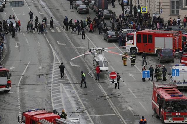 General view of emergency services attending the scene outside Sennaya Ploshchad metro station in St. Petersburg, Russia April 3, 2017. (Photo by Anton Vaganov/Reuters)