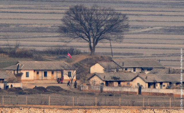 The North Korean village of Gaepung-Gun and it's inhabitants are seen from a South Korean observation post