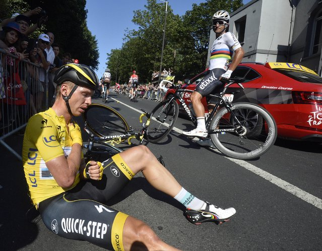Etixx-Quick Step rider Tony Martin of Germany, race leader's yellow jersey, lies on the ground after a crash during the 191.5-km (118.9 miles) 6th stage of the 102nd Tour de France cycling race from Abbeville to Le Havre, France, July 9, 2015. (Photo by Stephane Mantey/Reuters)