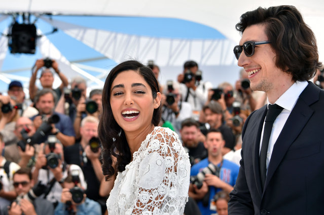 """French-Iranian actress Golshifteh Farahani (L) and US actor Adam Driver pose on May 16, 2016 during a photocall for the film """"Paterson"""" at the 69th Cannes Film Festival in Cannes, southern France. (Photo by Loic Venance/AFP Photo)"""