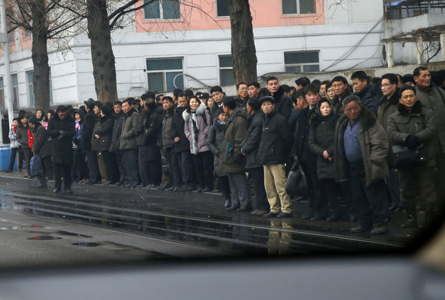 In this Sunday, February 3, 2019, photo, people ride on a stand on the side walk as they wait for tram in Pyongyang, North Korea. Pyongyang is upgrading its overcrowded mass transit system with brand new subway cars, trams and buses in a campaign meant to show leader Kim Jong Un is raising the country's standard of living. (Photo by Dita Alangkara/AP Photo)
