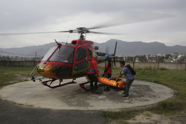 The body of famed Swiss climber Ueli Steck is unloaded from a helicopter at Teaching Hospital in Kathmandu, Nepal, April 30, 2017. 40-year-old Steck, one of the most-renowned mountaineers of his generation, was killed Sunday in a mountaineering accident near Mount Everest in Nepal, expedition organizers said. He was best known for his speed-climbing, including setting several records for ascending the north face of the Eiger, a classic mountaineering peak in the Bernese Alps that he climbed in two hours and 47 minutes without using a rope. (Photo by Niranjan Shrestha/AP Photo)