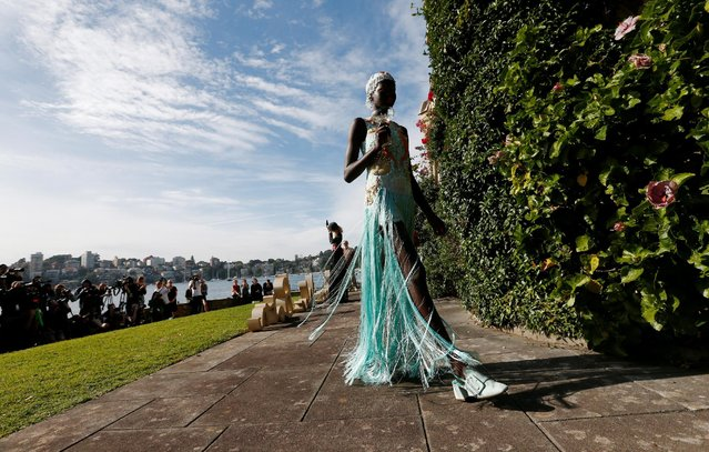 A model parades past an old sandstone chapel during a fashion show for the label Romance Was Born on the waterfront of Sydney Harbour during Australian Fashion Week, Sydney, Australia May 18, 2016. (Photo by Jason Reed/Reuters)