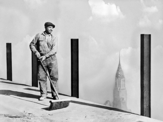 "A workman sweeping the highest sidewalk in the world, the 81st story of the Empire State Building, the world's tallest building, to the top of which the greatest dirigible ""Los Angeles"" will attempt to moor, New York, New York, early 1930s. This photo was made 1,248 feet above street level. (Photo by Adam Glickman/Underwood Archives/Getty Images)"