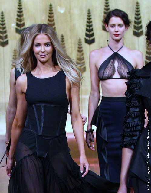 Model Jennifer Hawkins (L)  showcases designs by Toni Maticevski on the catwalk at the Myer A/W 2012 Collection Launch