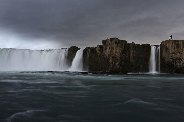 Visitors check out the waterfall known as Gooafoss on June 1, 2017 near Lake Myvatn, Iceland. Iceland's tourism industry continues to thrive; just eight years ago Iceland welcomed approximately 464,000 tourists and by last year nearly 1.7 million people visited the nation. (Photo by Joe Raedle/Getty Images)