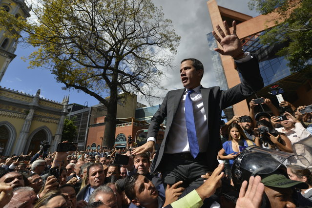 Opposition leader Juan Guaido argues for National Guards to let him and all opposition lawmakers into the National Assembly, saying he will not enter unless all of them are allowed entry, outside the legislature in Caracas, Venezuela, Tuesday, January 7, 2020. Venezuela's opposition is facing its biggest test yet after government-backed lawmakers announced they were taking control of what Guaidó supporters have described as the nation's last democratic institution. (Photo by Matias Delacroix/AP Photo)