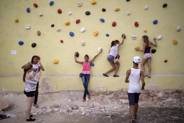 People interact with Muro de Empirismo, or Empiricism Wall, by Cuban artist Dayan Diaz, for the 12th Havana Biennial in Havana June 1, 2015. (Photo by Alexandre Meneghini/Reuters)