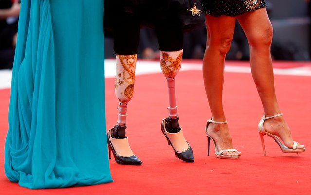 """Guests arrive at the red carpet for the movie """"The Truth"""" (La Verite) presented in competition at the 76th Venice Film Festival, in Venice, Italy, August 28, 2019. (Photo by Yara Nardi/Reuters)"""