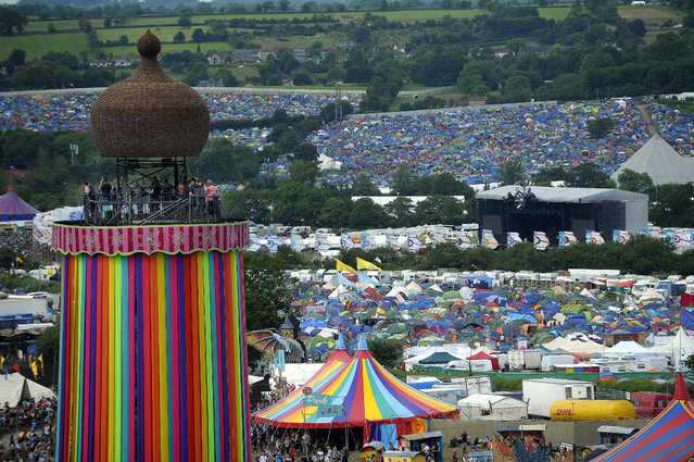 A general view shows the Ribbon Tower, tents and revellers on the second day of the Glastonbury Festival of Music and Performing Arts on Worthy Farm near the village of Pilton in Somerset, South West England on June 22, 2016. (Photo by Andy Buchanan/Reuters)