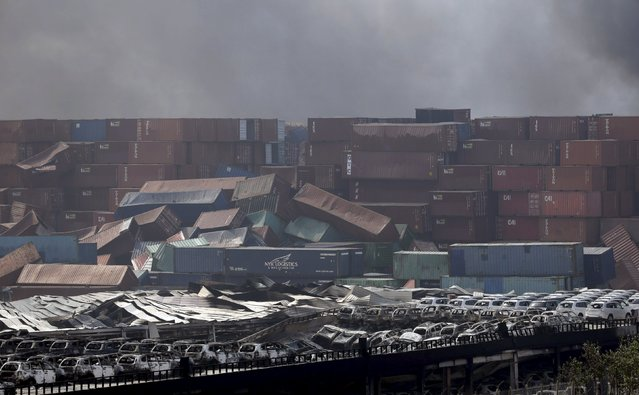 Damaged vehicles and overturned containers are seen near the site of the explosions at the Binhai new district, Tianjin, August 13, 2015. (Photo by Jason Lee/Reuters)