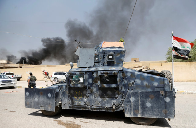 A military vehicle of Iraqi security forces is seen in Falluja, Iraq, June 25, 2016. (Photo by Thaier Al-Sudani/Reuters)