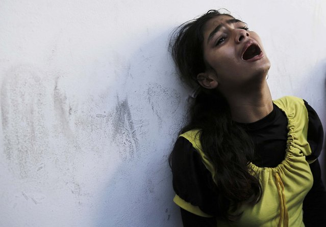 A displaced Palestinian girl who lost her relative in an Israeli airstrike at a U.N school cries at Beit Hanoun hospital in the northern Gaza Strip, on Jule 24, 2014. (Photo by Adel Hana/Associated Press)