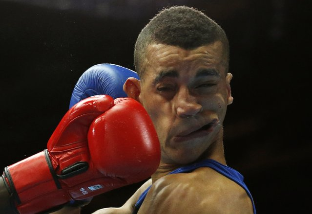 Kenya's Denis Okoth lands a punch on England's Samuel Maxwell during their men's Light Welterweight boxing fight at the Commonwealth Games in Glasgow, Scotland, July 27, 2014. (Photo by Jim Young/Reuters)