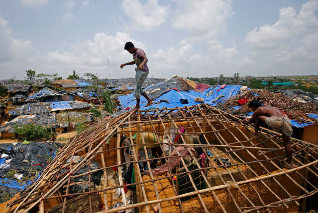 Rohingya refugees rebuild their makeshift house, which was destroyed by Cyclone Mora, at the Kutupalang Makeshift Refugee Camp in Cox's Bazar, Bangladesh June 1, 2017. (Photo by Mohammad Ponir Hossain/Reuters)
