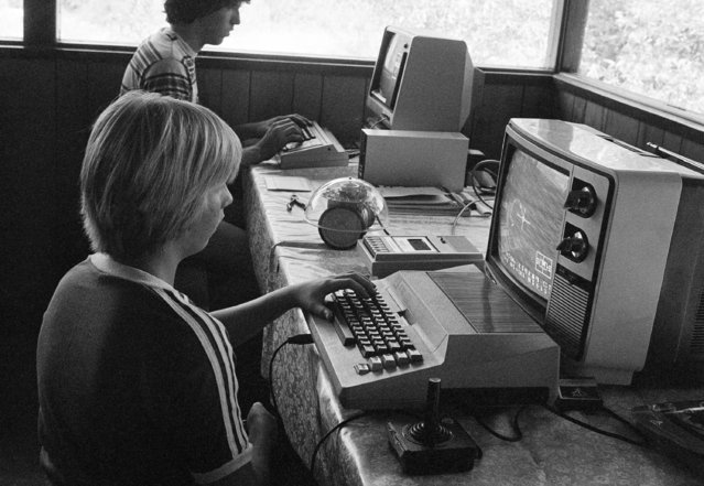 "Greg Berman, 12, of Santa Barbara, Calif. sits at computer console at California Computer Camp near Santa Barbara on July 29, 1980. The camp is a place where, its founder and President Denison Bollay says children are prepared for ""what it's going be like a decade from now"" in a world increasingly reliant upon computers. (Photo by AP Photo/Hyman)"