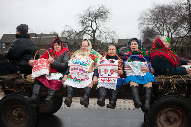 "Local women in the village of Tonyezh in Belarus join the Chyrachka celebrations on March 10, 2019. The old custom celebrates spring and is associated with the arrival of a small waterfowl duck, which in this area is called ""chyrachka"". (Photo by Radio Free Europe/Radio Liberty)"