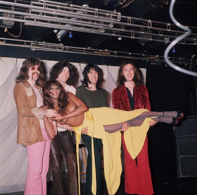 Scottish hard rock quartet Nazareth, comprising vocalist Dan McCafferty, guitarist Manny Charlton, bassist Pete Agnew, and drummer Darrell Sweet, carrying a naked woman between them, circa 1975. (Photo by Keystone)