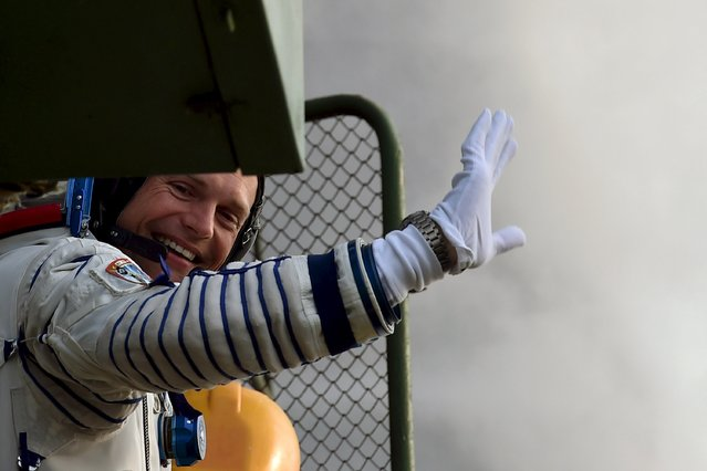 Denmark's astronaut Andreas Mogensen from the European Space Agency waves as he boards the Soyuz TMA-18M spacecraft at the Russian-leased Baikonur cosmodrome early September 2, 2015. (Photo by Kirill Kudryavtsev/Reuters)